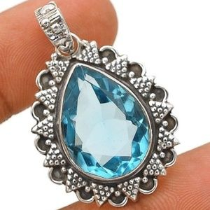 Jewelry - 12CT Blue Topaz ~ .925 Sterling Silver Pendant